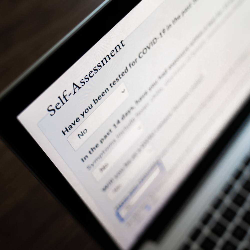 Image of the self-assessment form on a laptop computer screen